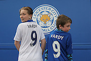 Leicester City fans with Leicester City forward Jamie Vardy (9) shirts on during the Barclays Premier League match between Leicester City and West Ham United at the King Power Stadium, Leicester, England on 17 April 2016. Photo by Simon Davies.