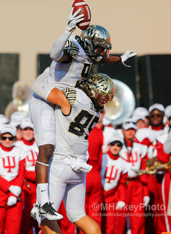 BLOOMINGTON, IN - SEPTEMBER 24: Chuck Wade #9 and Greg Dortch #89 of the Wake Forest Demon Deacons celebrate a touchdown during the game against the Indiana Hoosiers at Memorial Stadium on September 24, 2016 in Bloomington, Indiana. (Photo by Michael Hickey/Getty Images) *** Local Caption *** Chuck Wade; Greg Dortch