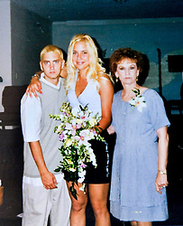 19 Jan,2006. Collect photograph.  Happier days near St Joseph, Kansas. Eminem's maternal grandmother Betty Kresin (rt) with her famous rapper grandson Marshall Bruce Masthers III, aka Eminem at his first wedding to Kimberly Anne Scott in 1999. Betty (in 2006) is sad and disappointed that she and her family in Kansas, including Eminem's mother Debbie Nelson were not invited to his recent re-marriage to Kim. <br /> Photo Credit: Kresin via  www.varleypix.com