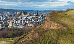 View of city of Edinburgh over Salisbury Crags from Arthur's Seat , Edinburgh, Scotland, UK.