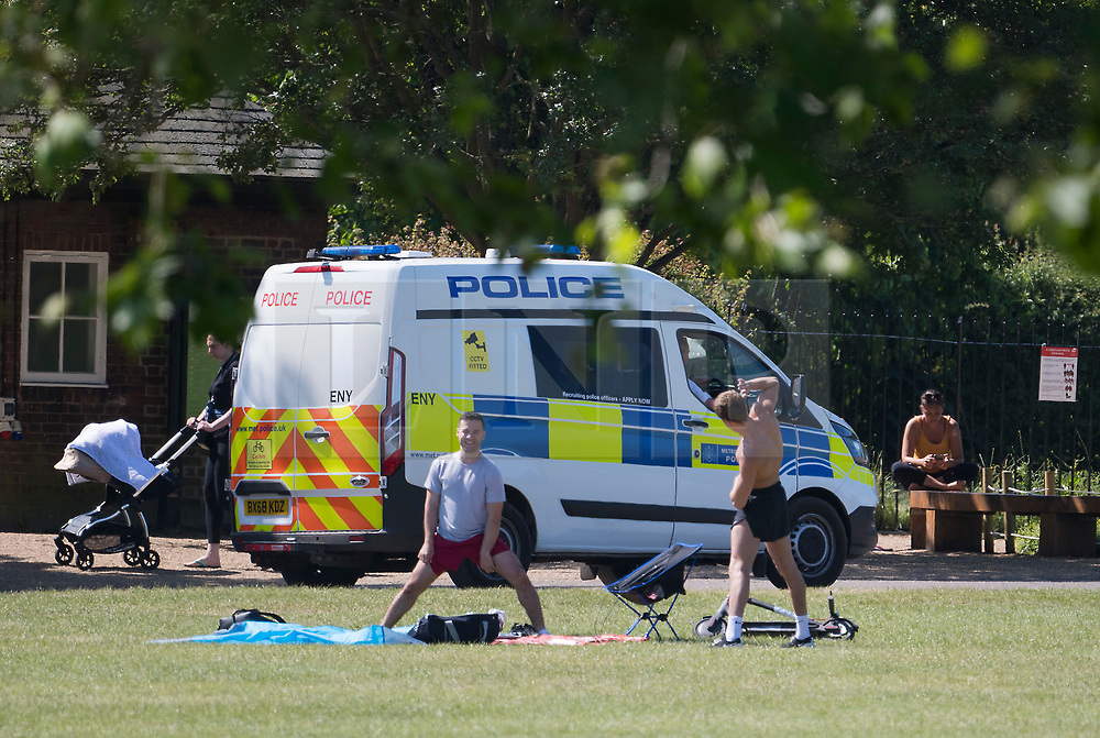 © Licensed to London News Pictures. 01/06/2020. London, UK. Police officer continue to patrol around Primrose Hill in North London, during lockdown. Government has introduced further measures to slowly ease lockdown, in an attempt to fight the spread of the COVID-19 strain of coronavirus. Photo credit: Ben Cawthra/LNP