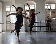 Dancers practise at the Centro de promoción de la Danza, a ballet school founded by Laura Alonso. Laura Alonso is the daughter of Alicia Alonso, the founder of the Cuban National Ballet and a World Premier Ballerina.