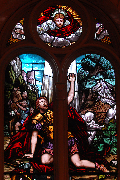 Saul is struck down and blinded. Jesus appears above him in this stained glass image. (Sam Lucero photo)