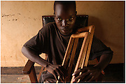 Bea Ahbeck/Fremont Argus<br /> <br /> Former child soldier Richard Opiro, 18, who was abducted at the age of 12, sits at the World Vision Rehabilitation Center in Gulu, northern Uganda, Friday, Oct. 28, 2005.