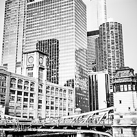 Black and white picture of Chicago at LaSalle Street Bridge (Marshall Suloway Bridge) with the Reid Murdoch Building / Encyclopaedia Britannica Building (325 North LaSalle Street), Quaker Tower (321 North Clark Street), 353 North Clark Street Building, Westin Chicago River North (320 North Dearborn Avenue), Marina City Towers (300 North State Street) and Trump International Hotel and Tower (401 North Wabash Avenue)