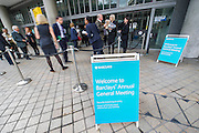 Protestors complaining about the use of tax havens, banks support for coal mining and the lack of a robin hood tax on financial transactions gather outside the Festival Hall as Barclays plc shareholders queue for the bank's AGM. Southbank, London, UK 24 April 2014.