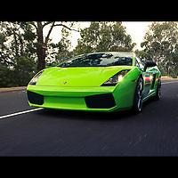A Lamborghini Gallardo leads a Ferraro F430 on the road