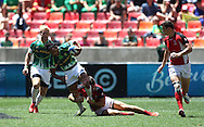 Justin Geduld of South Africa gets tackled during the match between South Africa and Canada of the HSBC Sevens World Series Port Elizabeth Leg held at the Nelson Mandela Bay Stadium on 7th December 2013 in Port Elizabeth, South Africa. Photo by Shaun Roy