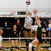 18 November 2017:  The San Diego State women's volleyball team closes out it's season against #24 Colorado State University. San Diego State middle blocker Deja Harris (15) spikes the ball over a CSU defender in the second set. The Aztecs fell to the Rams in three sets. <br /> www.sdsuaztecphotos.com
