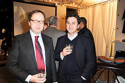 Left to right, ALEXANDER VAN STRAUBENZEE and his son THOMAS VAN STRAUBENZEE at reception to raise funds for a Ugandan School Project supported by the Henry van Straubenzee Memorial Fund held at Few & Far, 242 Brompton Road, London SW3 on 11th February 2010.
