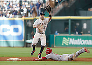Jun 22, 2016; Houston, TX, USA; Los Angeles Angels center fielder Shane Robinson (17) steals second base against Houston Astros designated hitter Jose Altuve (27) in the ninth inning at Minute Maid Park. Astros won 3 to 2. Mandatory Credit: Thomas B. Shea-USA TODAY Sports