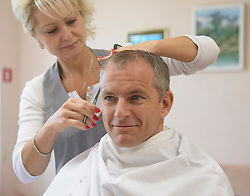 October 9, 2018 - Baikonur, Kazakhstan - Expedition 57 backup crewmember David Saint-Jacques of the Canadian Space Agency gets his hair cut, Tuesday, Oct. 9, 2018 at the Cosmonaut Hotel in Baikonur, Kazakhstan. Expedition 57 Flight Engineer Nick Hague of NASA and Flight Engineer Alexey Ovchinin of Roscosmos  are scheduled to launch onboard a Soyuz rocket October 11 and will spend the next six months living and working aboard the International Space Station. (Credit Image: ? Bill Ingalls/NASA via ZUMA Wire/ZUMAPRESS.com)