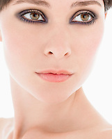 Young Woman Wearing Eye Makeup close up head shot