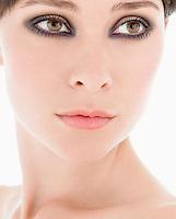 Young Woman Wearing Eye Makeup close up head shot