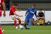 AFC Wimbledon Kyron Stabana (14) battles for possession during the Pre-Season Friendly match between AFC Wimbledon and Bristol City at the Cherry Red Records Stadium, Kingston, England on 9 July 2019.