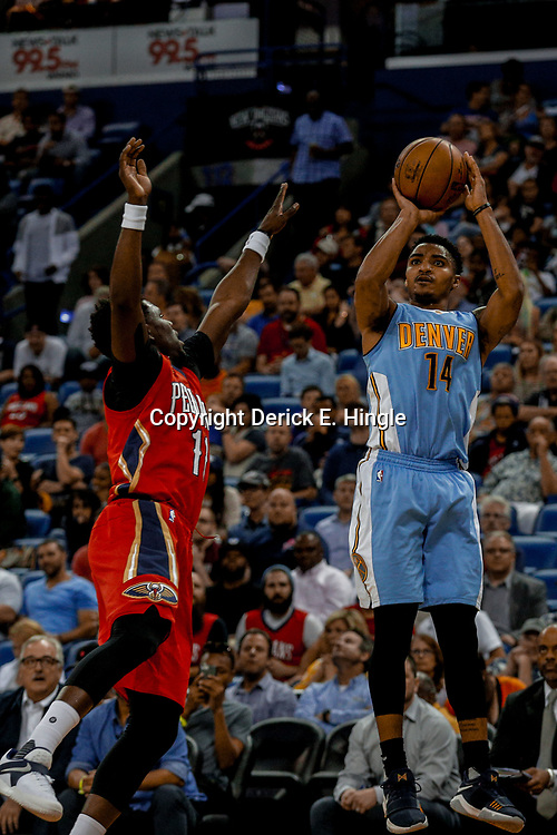 Apr 4, 2017; New Orleans, LA, USA; Denver Nuggets guard Gary Harris (14) shoots over New Orleans Pelicans guard Jrue Holiday (11) during the first quarter of a game at the Smoothie King Center. Mandatory Credit: Derick E. Hingle-USA TODAY Sports