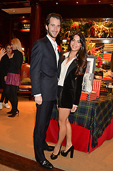 The HON.WILL ASTOR and his wife LOHRALEE at a party to celebrate the publication of 'A Designer's Life' by Nicky Haslam held at Ralph Lauren, 1 New Bond Street, London on 19th November 2014.