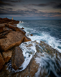 Sunset and rising tide at Portland Bill in Dorset