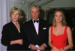 Left to right, MR & MRS RICHARD HAMBRO he is the banker and their daughter MISS CLEMENTINE HAMBRO, at a ball in London on 24th September 1997.<br /> MBM 36