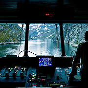 Three weeks aboard the Kong Harald. Hurtigruten, the Coastal Express. Navigation inside the Trollfjord. From the bridge of the Kong Harald. Lofotens.