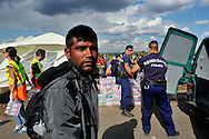 Refugee arriving at a 'collection point' a kilometre inside the border with Serbia along a disused railway line. Hungarian police are unloading water and other supplies to be given to the refugees by volunteers, who have been providing basic supplies all day from their own sources. The flow  into Hungary continues unabated. Refugees, most from Syria, simply walked through a hole in the border fence with Serbia by the hundreds on Sunday, only to be stopped by police and held in a field a kilometre away.  The official border reception centres are full and refugees must camp on the ground, dependent mostly on food donated by volunteer groups