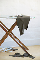 Cut pieces of fabric on ironing board