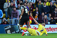 Troy Deeney of Watford is fouled by Alan Dunne of Millwall which leads to a free kick from which Watford score their second goal during the Sky Bet Championship match at Vicarage Road, Watford<br /> Picture by David Horn/Focus Images Ltd +44 7545 970036<br /> 01/11/2014