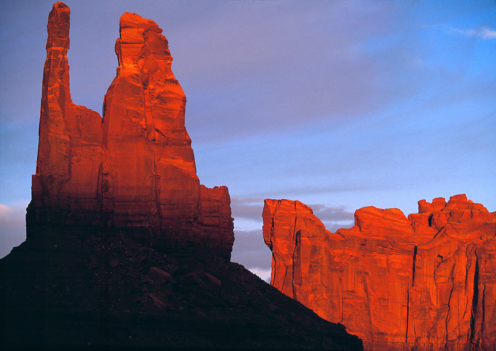 The King on a Throne takes on red hues in evening light at Monument Valley, Utah.