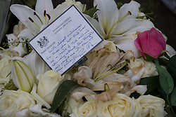 © Licensed to London News Pictures . 27/03/2017 . London , UK . A wreath of white roses sent by British Prime Minister Theresa May amongst flowers and tributes in Parliament Square opposite Parliament in Westminster , in response to Khalid Masood's terrorist attack and the killing of PC Keith Palmer . Photo credit: Joel Goodman/LNP