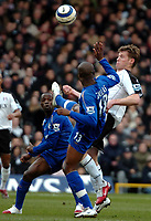 Photo: Ed Godden.<br /> Fulham v Chelsea. The Barclays Premiership. 19/03/2006.<br /> Brian McBride (R) clashes with Chelseas William Gallas