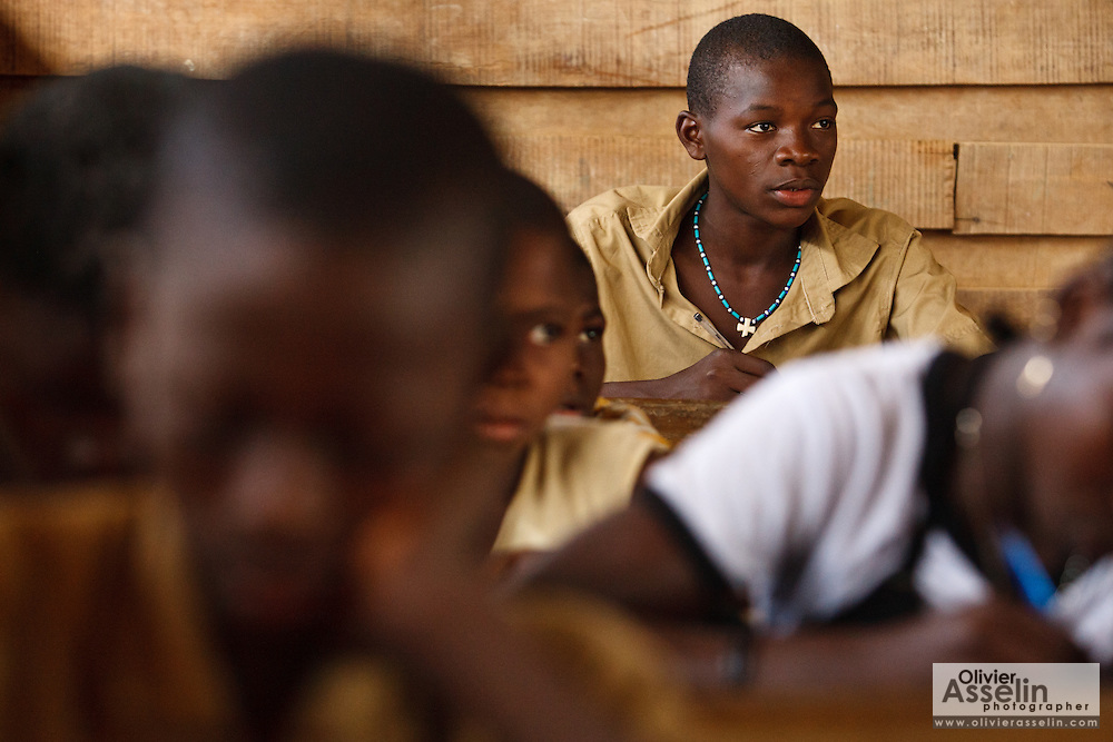 A boy looks up while attending class at the Podio primary school in the village of Podio, Bas-Sassandra region, Cote d'Ivoire on Friday March 2, 2012.