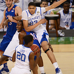 Apr 2, 2012; New Orleans, LA, USA; Kentucky Wildcats forward Anthony Davis (23) collides with Kansas Jayhawks guard Tyshawn Taylor (10) as guard Doron Lamb (20) gains possession of the ball during the first half in the finals of the 2012 NCAA men's basketball Final Four at the Mercedes-Benz Superdome. Mandatory Credit: Derick E. Hingle-US PRESSWIRE