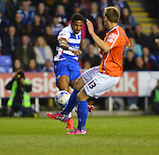 Reading's Garath McCleary and Birmingham City's Robert Tesche during the Sky Bet Championship match between Reading and Birmingham City at the Madejski Stadium, Reading, England on 22 April 2015. Photo by Mark Davies.