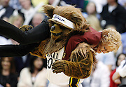 """The Utah Jazz mascot """"Bear"""" twirls a security guard during a timeout in the second half of Game 3 against the San Antonio Spurs in the first-round NBA basketball playoff series, Saturday, May 5, 2012, in Salt Lake City. The Spurs defeated the Jazz 102-90 to lead the series 3-0. (AP Photo/Colin E Braley)"""