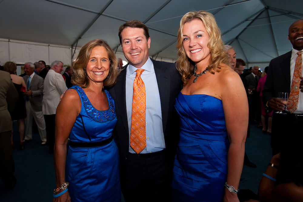 SARASOTA, FL -- May 20, 2011 -- Sally Muehlen, left, to right, Oklahoma State University coach Travis Ford, and Jeri Stull pose for a photo during the 6th Annual Dick Vitale Gala at the Ritz-Carlton Sarasota on May 20, 2011.  Money raised goes to the V Foundation for cancer research.   (PHOTO / CHIP LITHERLAND)