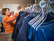 18 OCTOBER 2019 - CRAWFORDSVILLE, IOWA: US Senator AMY KLOBUCHAR (D-MN) looks at the uniforms left by laid off workers at W2 Fuel, a biodiesel refinery that used soybeans to make biodiesel. W2 Fuel closed about a month ago because of low demand for biofuels, brought on by the number of biofuels waivers the US EPA has given to petroleum refineries. Sen. Klobuchar is on barnstorming bus tour of southeast Iowa this weekend. She is campaigning to be the Democratic nominee for the US Presidency. In addition to campaign meet and greet events, she stopped at a biofuels plant to learn about the difficulties farmers and biofuels producers face because of the trade war with China. Iowa holds the first selection event of the Presidential election cycle. The Iowa caucuses are Feb. 3, 2020.        PHOTO BY JACK KURTZ