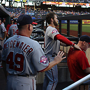 Bryce Harper, Washington Nationals, in the dugout giving a massage to Matt Williams, Washington Nationals Manager before the New York Mets Vs Washington Nationals MLB regular season baseball game at Citi Field, Queens, New York. USA. 31st July 2015. Photo Tim Clayton