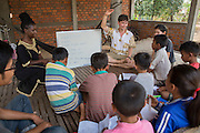 ICS volunteers Tania Tuzizila and Dan Hensman run a weekly English class for all children in the village at their host home, in the village of in Banteay Char, near Battambang, Cambodia.