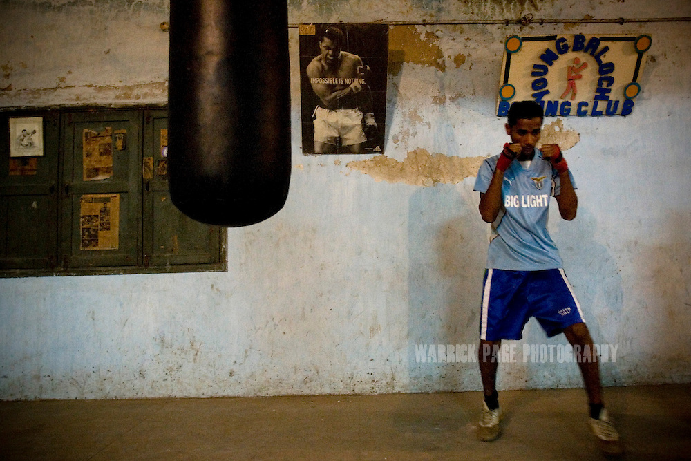 KARACHI, PAKISTAN - OCTOBER 12: A member of the Young Baloch Boxing Club attends training, Sunday, October 12, 2008, in Karachi, Pakistan. Lyari is Karachi's poorest, most dangerous, drug and crime-infested slum, but has produced the bulk of Pakistan's champion boxers. Boxing has been a way of survival for many of the young men, who are often sponsored by corporations and event the military, to box for them at events throughout the city and the country. Lacking in the most basic resources, including a sufficient diet, the young boxers have watched countless champions on television throughout the years, attempting to emulate their abilities. (Photo by Warrick Page)