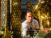 "04 SEPTEMBER 2015 - BANGKOK, THAILAND: A Brahman priest blesses the Four Faced Brahma statue at the Erawan Shrine during a rededication ceremony Friday. A ""Holy Religious Ceremony for Wellness and Prosperity of our Nation and Thai People"" was held Friday morning at Erawan Shrine. The ceremony was to regain confidence of the Thai people and foreign visitors, to preserve Thai religious customs and traditions and to promote peace and happiness inThailand. Repairs to Erawan Shrine were completed Thursday, Sept 3 after the shrine was bombed on August 17. Twenty people were killed in the bombing and more than 100 injured. The statue of the Four Faced Brahma in the shrine was damaged by shrapnel and a building at the shrine was damaged by debris.    PHOTO BY JACK KURTZ"