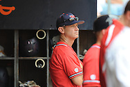 Mississippi Head Coach Mike Bianco (5) in the dugout vs. St. John's during an NCAA Regional game at Davenport Field in Charlottesville, Va. on Sunday, June 6, 2010. St. John's won 20-16.