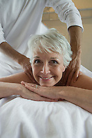 Portrait of senior woman having massage