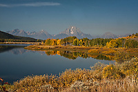 The Teton Range  and Oxbow Bend in autumn. The smoky haze is caused by a near by wild fire.  Grand Teton National Park, Wyoming, USA.