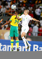 Islam Slimani of Algeria (R) in aerial contest against Thulani Hlatshawyo of South Africa their AFCON match at the Estadio de Mongomo on January 19, 2015.Algeria won 3-1.Photo/Mohammed Amin/www.pic-centre.com (Equatorial Guinea)