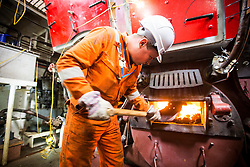 """© Licensed to London News Pictures. 04/05/2016. Birkenhead UK. Fireman Michael Hulme fires up the Daniel Adamson boilers for the first time in 30 years. The Daniel Adamson steam boat has been bought back to operational service after a £5M restoration. The coal fired steam tug is the last surviving steam powered tug built on the Mersey and is believed to be the oldest operational Mersey built ship in the world. The """"Danny"""" (originally named the Ralph Brocklebank) was built at Camel Laird ship yard in Birkenhead & launched in 1903. She worked the canal's & carried passengers across the Mersey & during WW1 had a stint working for the Royal Navy in Liverpool. The """"Danny"""" was refitted in the 30's in an art deco style. Withdrawn from service in 1984 by 2014 she was due for scrapping until Mersey tug skipper Dan Cross bought her for £1 and the campaign to save her was underway. Photo credit: Andrew McCaren/LNP ** More information available here http://tinyurl.com/jsucxaq **"""