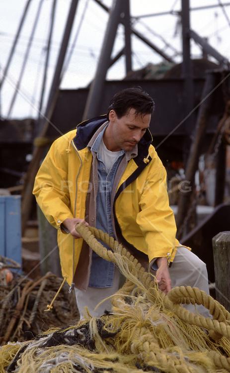 dock worker pulling rope