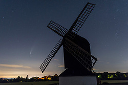 © Licensed to London News Pictures. 18/07/2020. PITSTONE, UK.  Comet C/2020 F3 NEOWISE, nicknamed comet NEOWISE is seen in the night sky over Pitstone Windmill in Buckinghamshire.  The comet was discovered by NASA's Near-Earth Object Wide-field Infrared Survey Explorer, or NEOWISE, on March 27 and is one of the few comets visible to the naked-eye of the 21st Century.  It will reach its closest distance to Earth on 23 July, about 64 million miles (103 million km) away. Pitstone Windmill dates back to around 1627 and is believed to be the oldest dated windmill in Britain. Photo credit: Stephen Chung/LNP