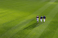 Joe Mauer #7, Pedro Hernandez #60, and Rick Anderson #40 head toward the dugout before a game against the Chicago White Sox on May 13, 2013 at Target Field in Minneapolis, Minnesota.  The Twins defeated the White Sox 10 to 3.  Photo: Ben Krause