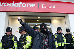 © under license to London News Pictures. 30/11/2010 A masked student stands in front of the Vodafone store in Bristol today (30/11/2010) where mustard and other items where thrown at police as part of demonstrations against proposed increases to higher education fees. Protests are taking place all over the UK. Credit should read: David Hedges/LNP
