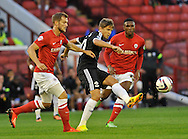 Picture by Richard Land/Focus Images Ltd +44 7713 507003<br /> 27/08/2013<br /> Gaston Ramirez of Southampton spreads the ball during the Capital One Cup match at Oakwell, Barnsley.